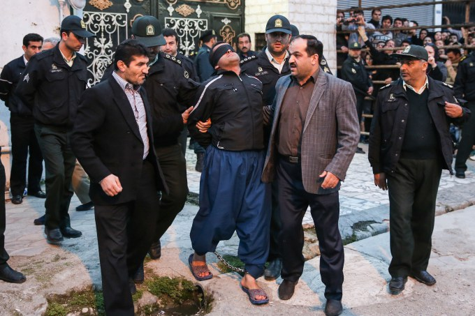 Balal is brought to the gallows by judicial officials during his execution ceremony in the northern city of Nowshahr on April 15, 2014.