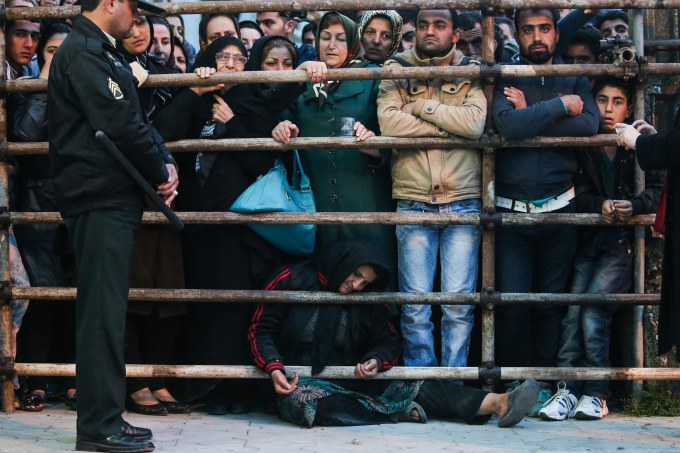Balal's mother (C) asks for the family's forgiveness as her son is brought to the gallows during his execution ceremony in the northern city of Nowshahr on April 15, 2014.