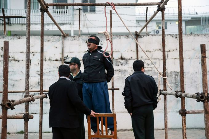 Balal reacts as he stands in the gallows during his execution ceremony in the northern city of Nowshahr on April 15, 2014.
