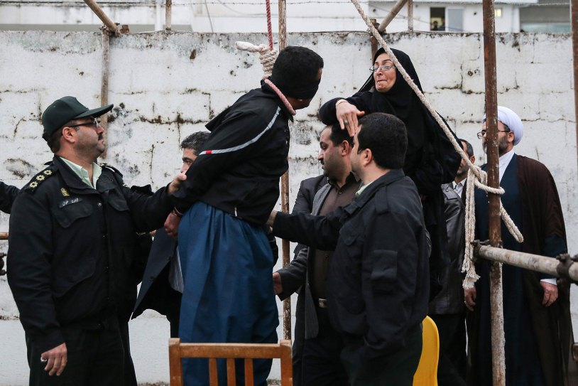The mother of Abdolah Hosseinzadeh, slaps Balal who killed her son during the execution ceremony in the northern city of Nowshahr on April 15, 2014.