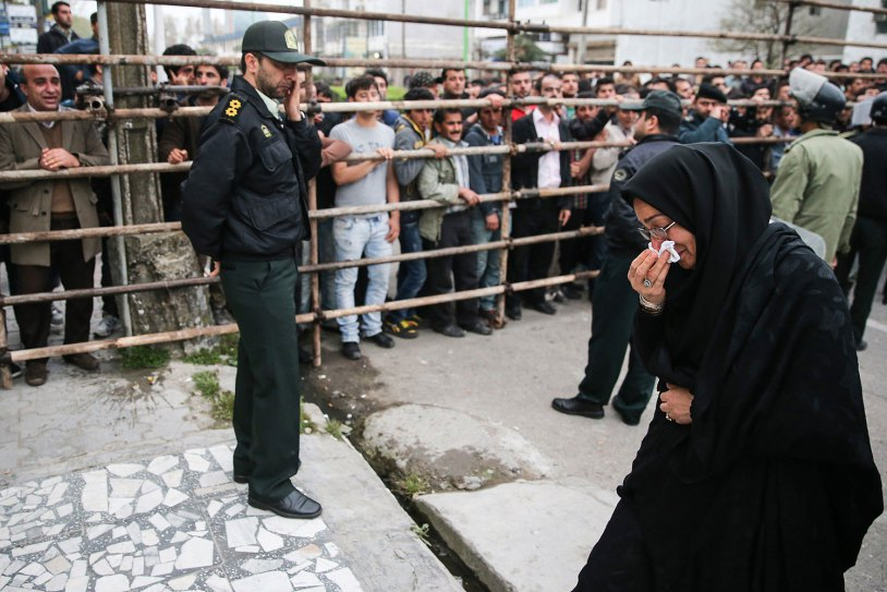 Samereh Alinejad, the mother of Abdolah Hosseinzadeh, cries after she spared the life of her son's convicted murderer with an emotional slap in the face as he awaited execution with the noose around his neck in the northern city of Nowshahr on April 15, 2014.