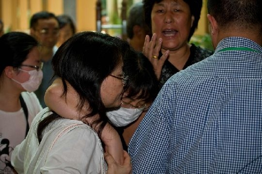 Families of Chinese passengers on board MAS flight MH370 arriving at the Royale Chulan Hotel in Kuala Lumpur today for a briefing by the Malaysian government