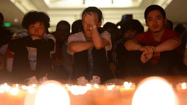 Chinese relatives of passengers on the missing Malaysia Airlines flight MH370 pray by candles at the Metro Park Hotel in Beijing on April 8, 2014. The families of the passengers and crew of flight MH370 will receive financial assistance from Malaysia Airlines (MAS) to ease their burdens, said Deputy Foreign Minister Datuk Hamzah Zainuddin. - See more at: http://www.straitstimes.com/news/asia/south-east-asia/story/mh370-malaysia-airlines-provide-financial-assistance-families-201404#sthash.bRhJc3Ty.dpuf