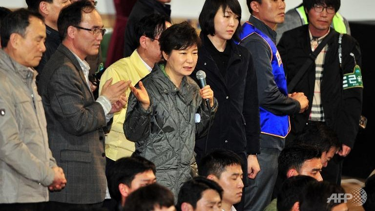 South Korea's President Park Geun-Hye (C) meets relatives of missing passengers on board the capsized ferry 'Sewol' as they wait for updates about their loved ones at a gym in Jindo.