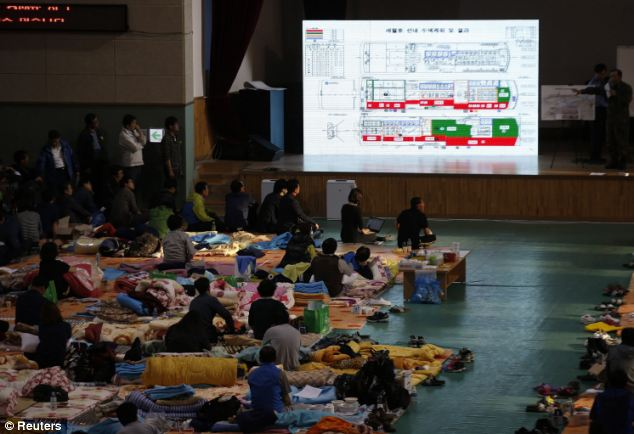 A South Korea navy officer gives a briefing about a rescue operation to the family members of missing passengers onboard the sunken passenger ship Sewol
