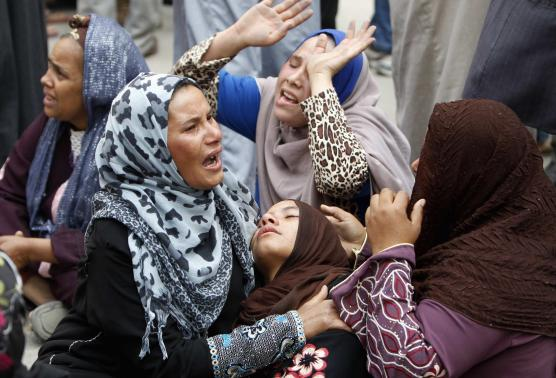 Relatives and families of members of Muslim Brotherhood and supporters of ousted President Mohamed Mursi react after hearing the sentence, in front of the court in Minya, south of Cairo, April 28.