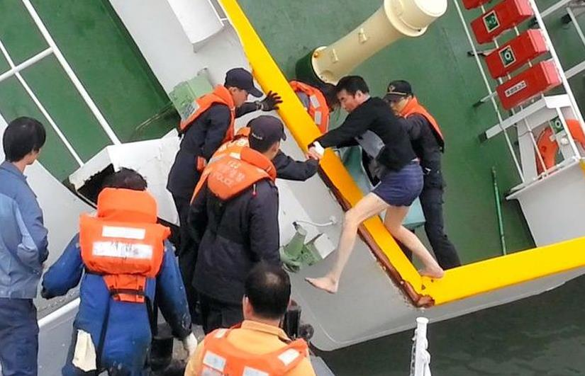 A barefoot Capt. Lee Joon-seok is rescued on April 16 from the listing ferry Sewol near Jindo island in the southwestern part of South Korea. The image was taken with a mobile phone by a member of the rescue team