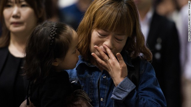 People attend a memorial for the victims of the sunken ferry Sewol