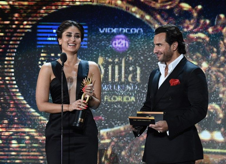 Bollywood actress Kareena Kapoor and Bollywood actor Saif Ali Khan present the award for Best Playback Male Singer on stage at the Raymond James Stadium.