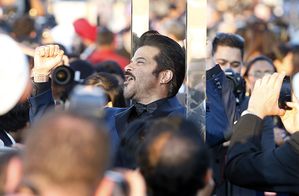 Indian film star Anil Kapoor walks the green carpet as he arrives for the 15th annual International Indian Film Awards on Saturday, April 26, 2014, in Tampa, Fla.