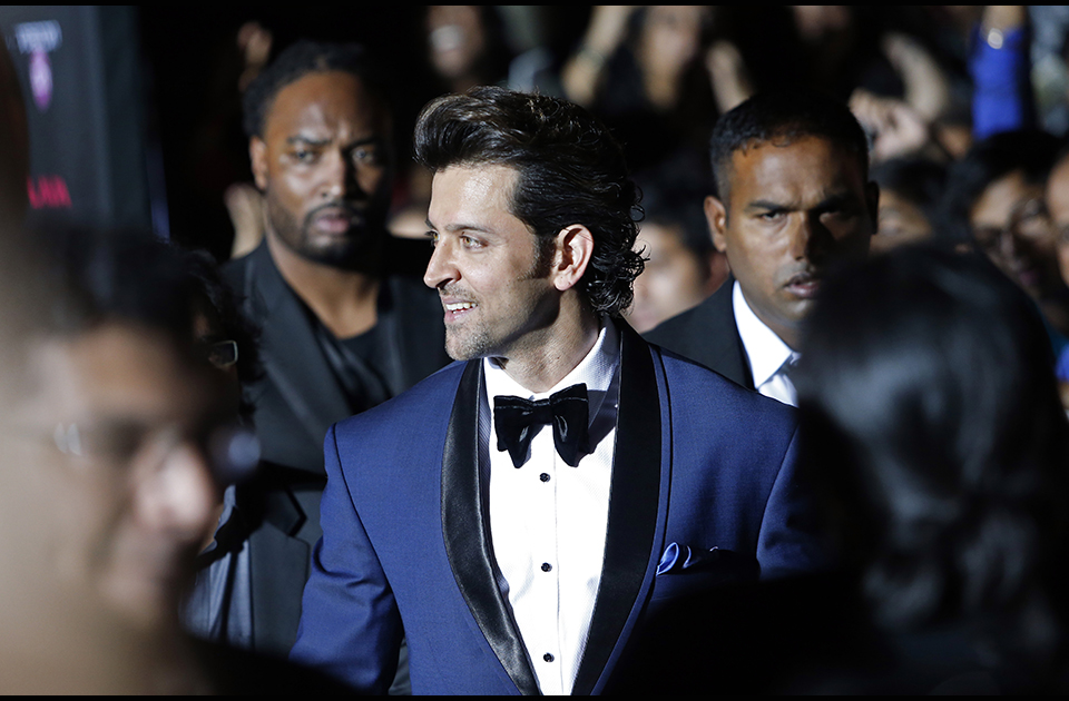 Indian film star Hrithik Roshan walks the green carpet as he arrives for the 15th annual International Indian Film Awards on Saturday, April 26, 2014, in Tampa, Fla.