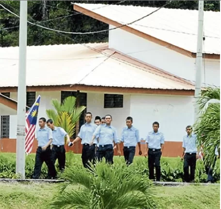 Some of the NS trainees at White Resort Camp in Balik Pulau yesterday. Bernama pic