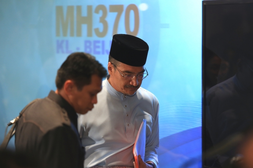 Hishammuddin Hussein leaving a MH370 press conference.