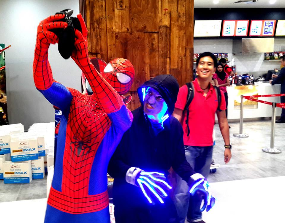 A person in a Spider-Man outfit takes a selfie with Electro, the fictional villain.