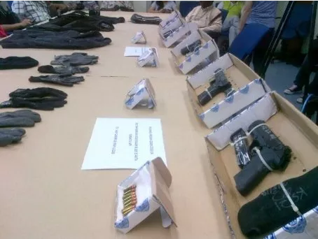 Some of the firearms, live bullets and clothing seized during the shootout.  Read more: 3 suspected criminals shot dead in JB - Latest - New Straits Times http://www.nst.com.my/latest/3-suspected-criminals-shot-dead-in-jb-1.586913#ixzz30oaHDIch