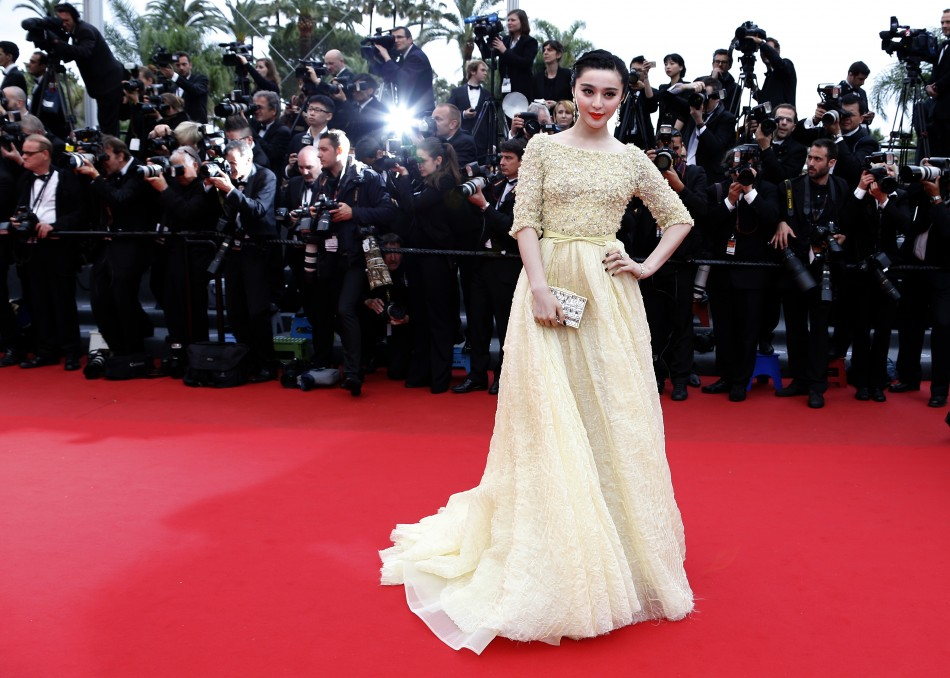 Fan Bingbing poses on the red carpet as she arrives for the screening of the film 'Jeune & Jolie' (Young & Beautiful) during the 2013 Cannes Film Festival.