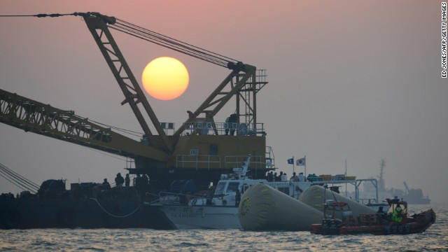 The sun sets over the site of the sunken ferry