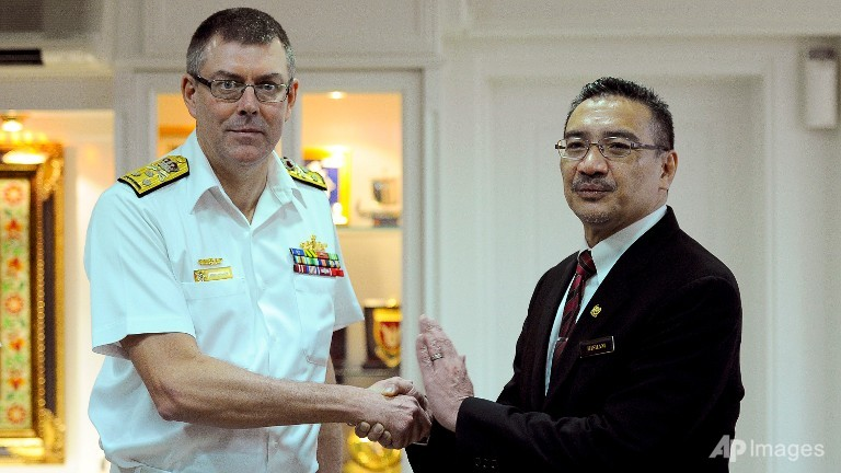 Chief of the Royal Australian Navy Vice Admiral Ray Griggs (L) and Malaysian Minister of Defence and Acting Transport Minister Hishammuddin Hussein shake hands prior to a meeting at the Ministry of Defense in Kuala Lumpur, Malaysia.
