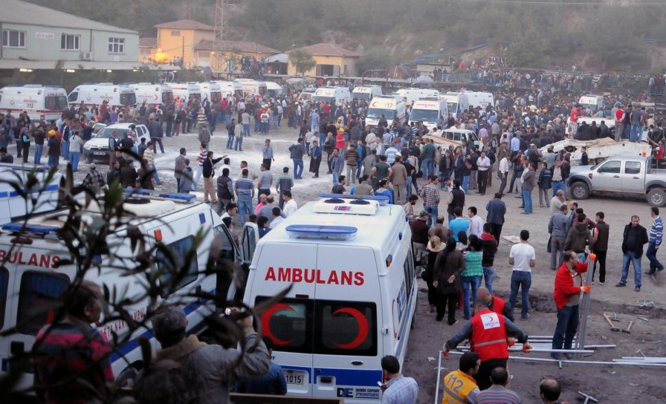 Medics, family members and friends wait outside a hospital hours after the explosion.