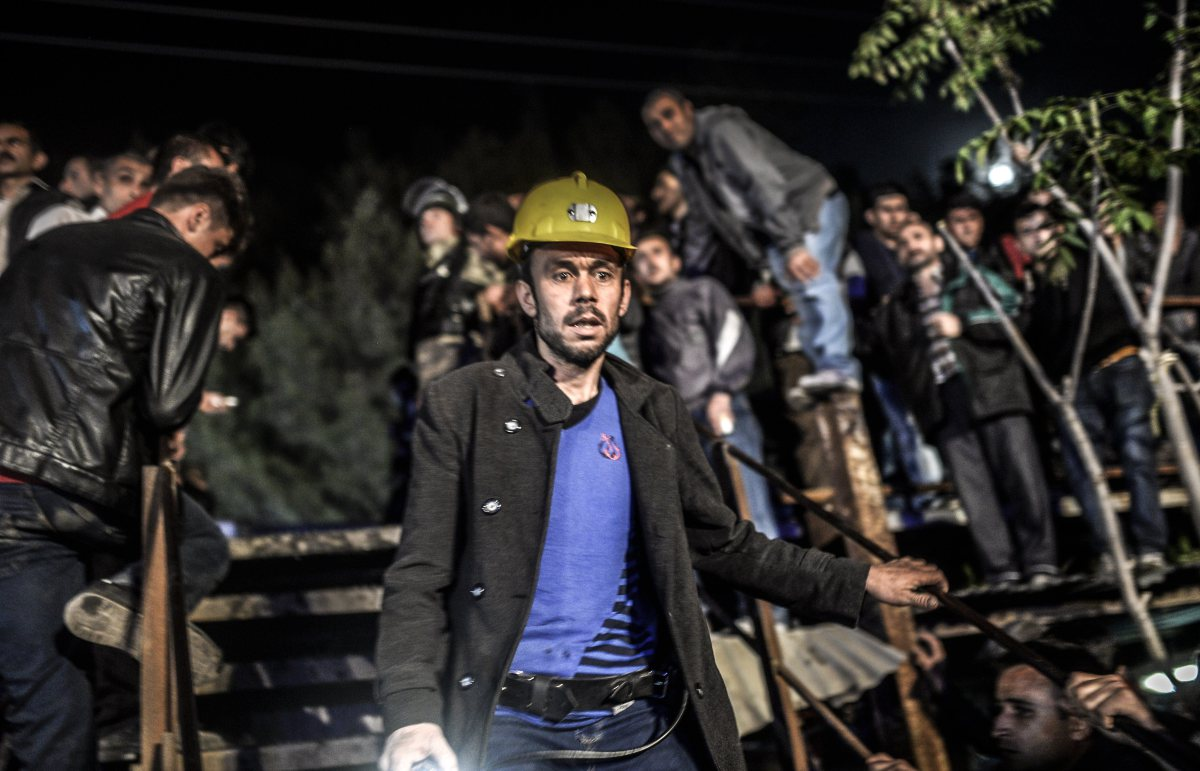 Miners wait at the gate of a mine after an explosion in Manisa