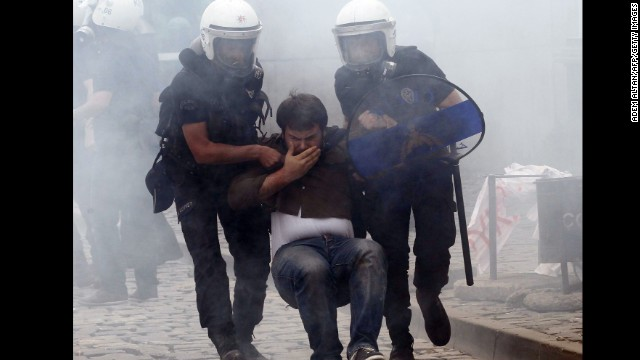Police arrest a protester in Ankara on May 14.