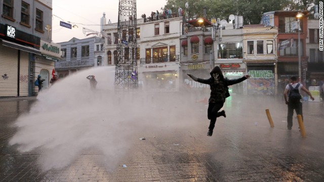Riot police use a water cannon to disperse protesters in Istanbul.
