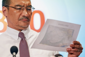 Datuk Seri Hishammuddin Hussein has said Putrajaya will seek to discuss with British satellite firm Inmarsat over the public release of the flight's raw data, in what can be described as a move to ease tensions between families of those aboard the missing flight and Malaysian search officials.