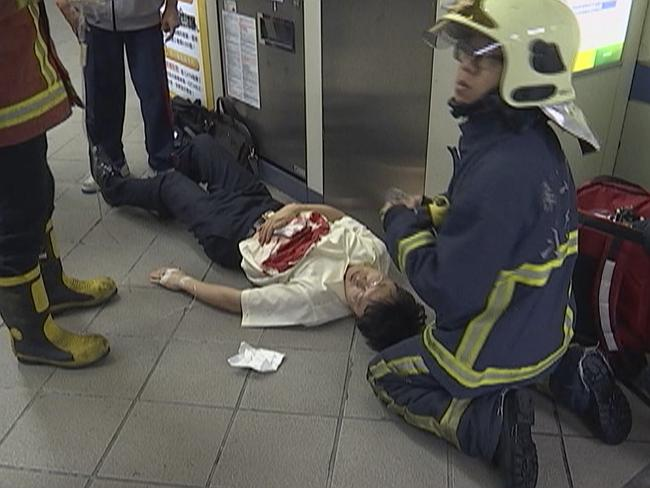 Paramedics are seen tending to a victim at a subway station in Taipei, Taiwan.