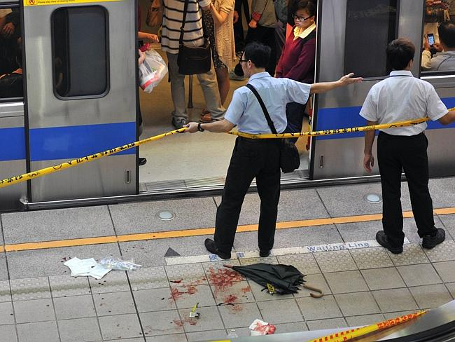 Police blockade the scene of a stabbing incident at the Jiangzicui Station