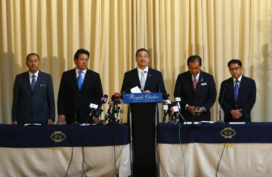 Defence Minister and acting Transport Minister Datuk Seri Hishammuddin Hussein (centre) with other top Malaysian officials involved in the MH370 investigations. Hishammuddin's recent defence of Malaysia's failure to scramble jets upon detecting the missing Malaysia Airlines on March 8 has renewed criticisms of his handling of the crisis