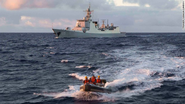 MH370 SAR: Chinese navy personnel head out on a boat to the Royal Australian Navy ship HMAS Success.