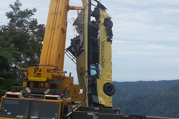 Rescuers retrieve the fallen Genting bus