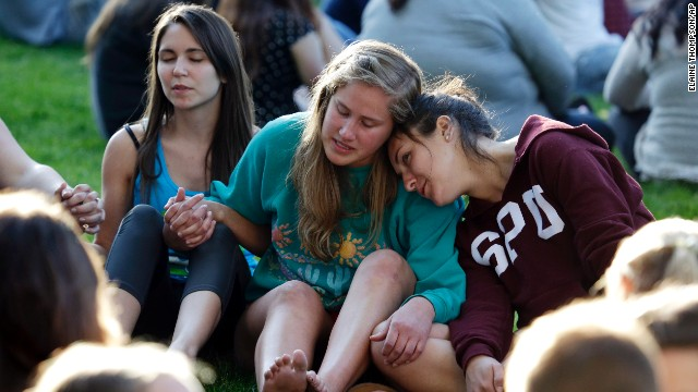 Students from Seattle Pacific University gather on campus in a prayer circle.
