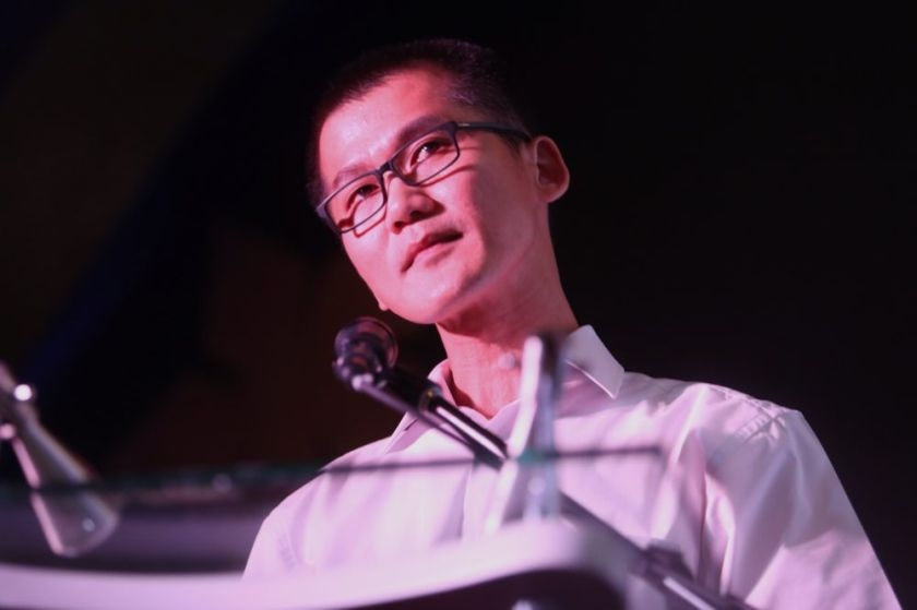 Lee Khim Fatt, husband of MH370 flight attendant Fong Wai Yueng, recites an emotional poem titled 'My Beloved' at the charity dinner organised by NUFAM at Hotel Empire Subang, June 7, 2014.
