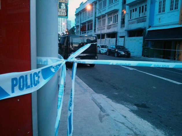 A picture of police lines cordoning off an area of Syed Alwi Road, where a body was found in a luggage