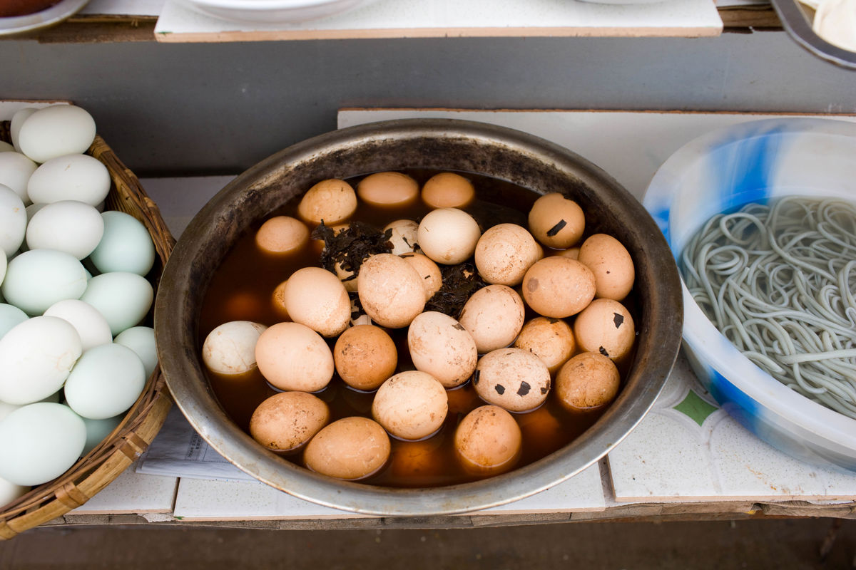 Preserved eggs sit on display at a food stall in Fengdu, China.