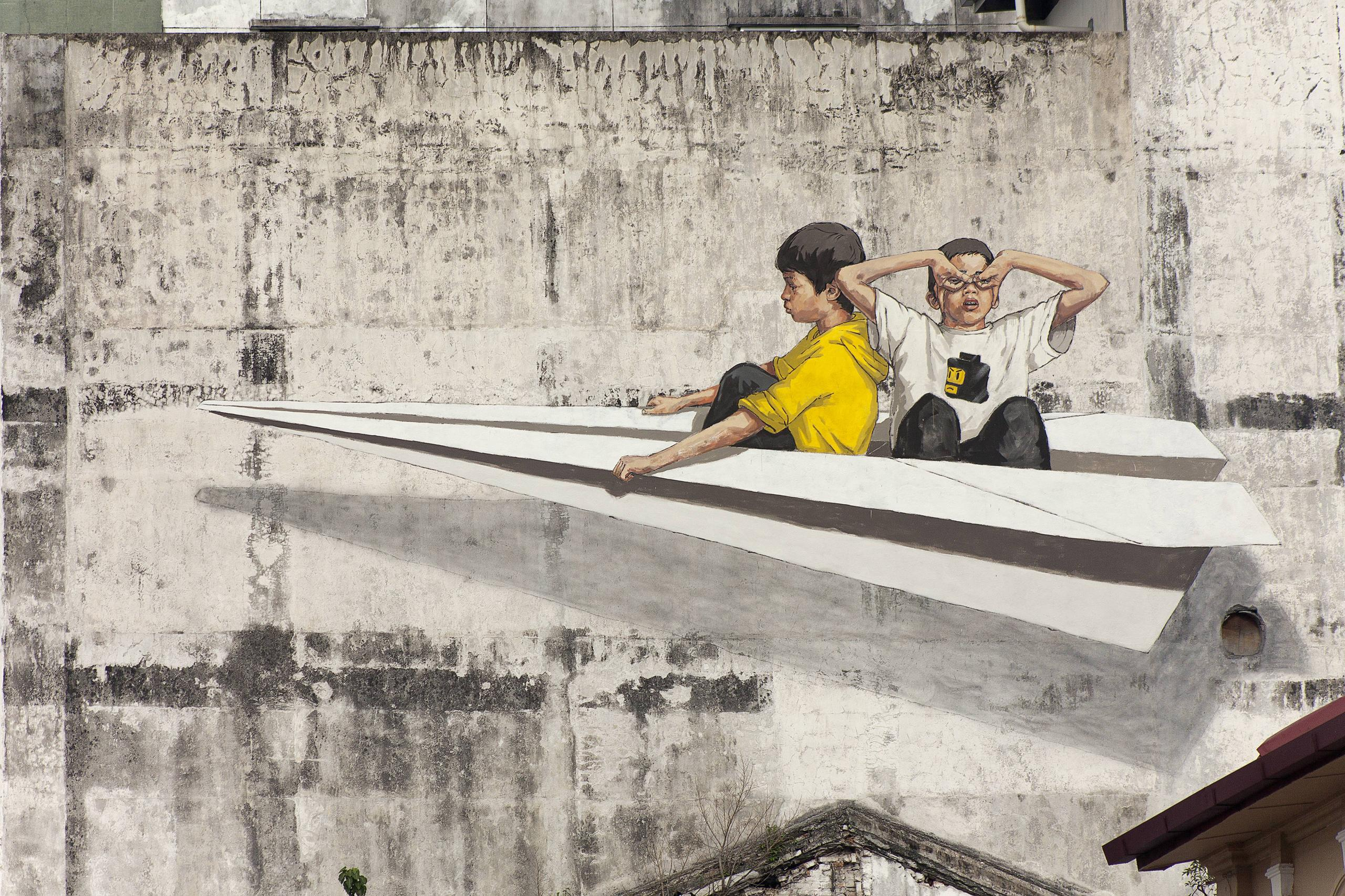 Paper plane mural by ernest zacharevic in old town ipoh image via oldtown white coffee malaysia