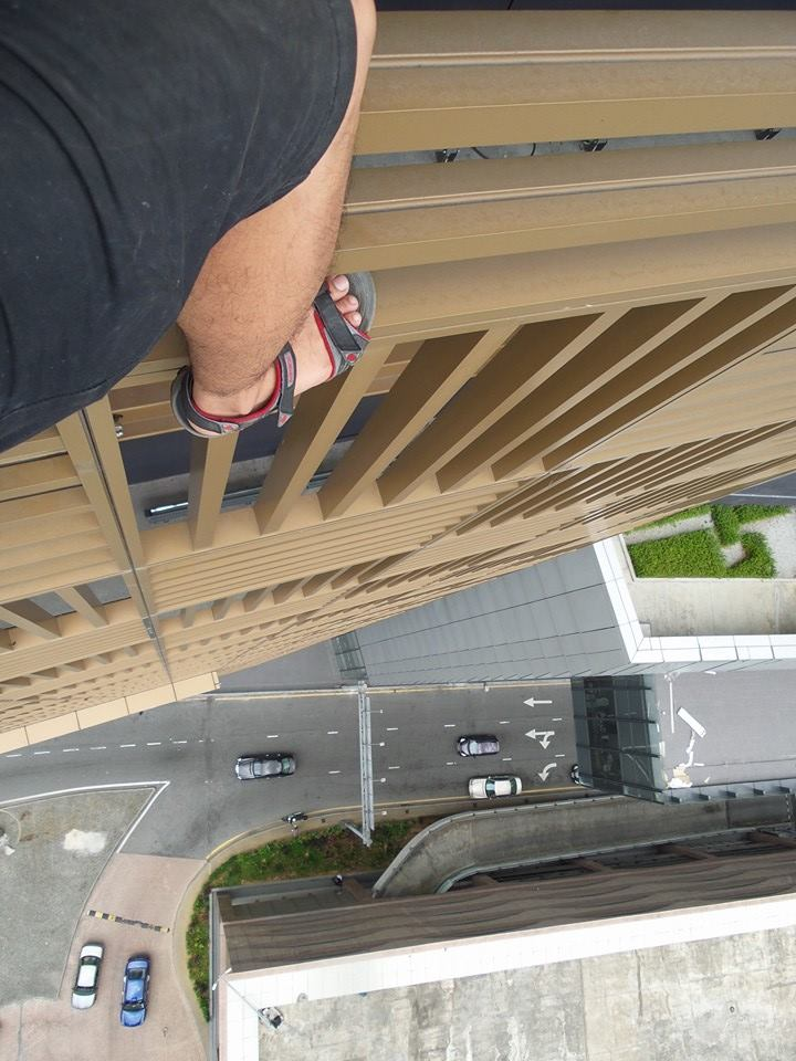 A 26-year-old Malaysian photographer climbing the 1 Sentrum tower in KL.