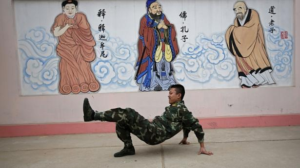 A student performs a dance during a break at the Qide Education Center in Beijing on Feb 26, 2014