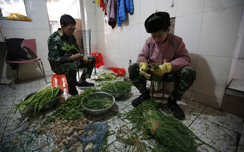 Students prepare vegetables as part of the education program