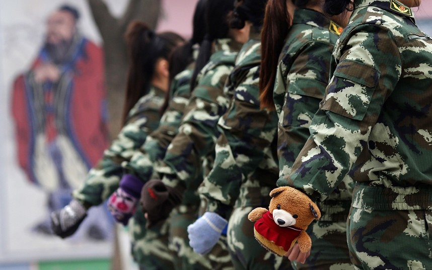 Female students take part in a military-style close-order drill class. Military-style boot camps, designed to wean young people off their addiction to the internet, number as many as 250 in China alone.