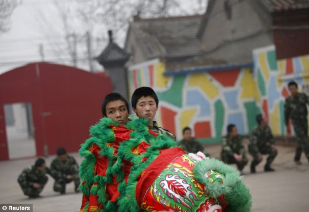 Besides the drill and physical exercises, the courses, which run between four and eight months, cover classes in music and Chinese lion dancing