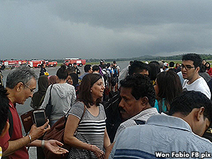 According to a passenger, the chaos broke lose due to a flight attendant who urged passengers to run out of the cabin.