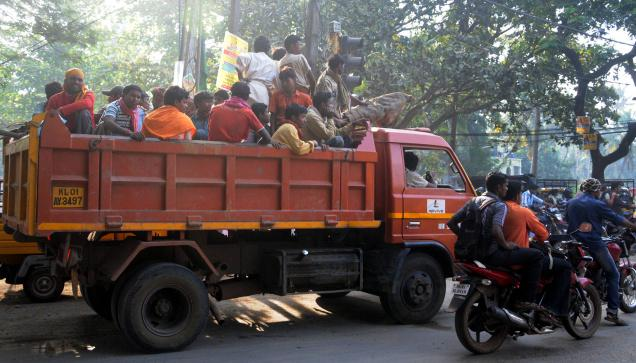 An unrelated photo of migrant labourers being transported in a truck to a work site in Kerala.