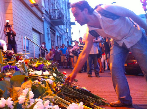People leaving flowers for the victims of MH17 at the Netherlands Embassy in Kiev, Ukraine.