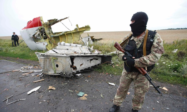 A separatist stands at the crash site of Malaysia Airlines flight MH17, near the settlement of Grabovo