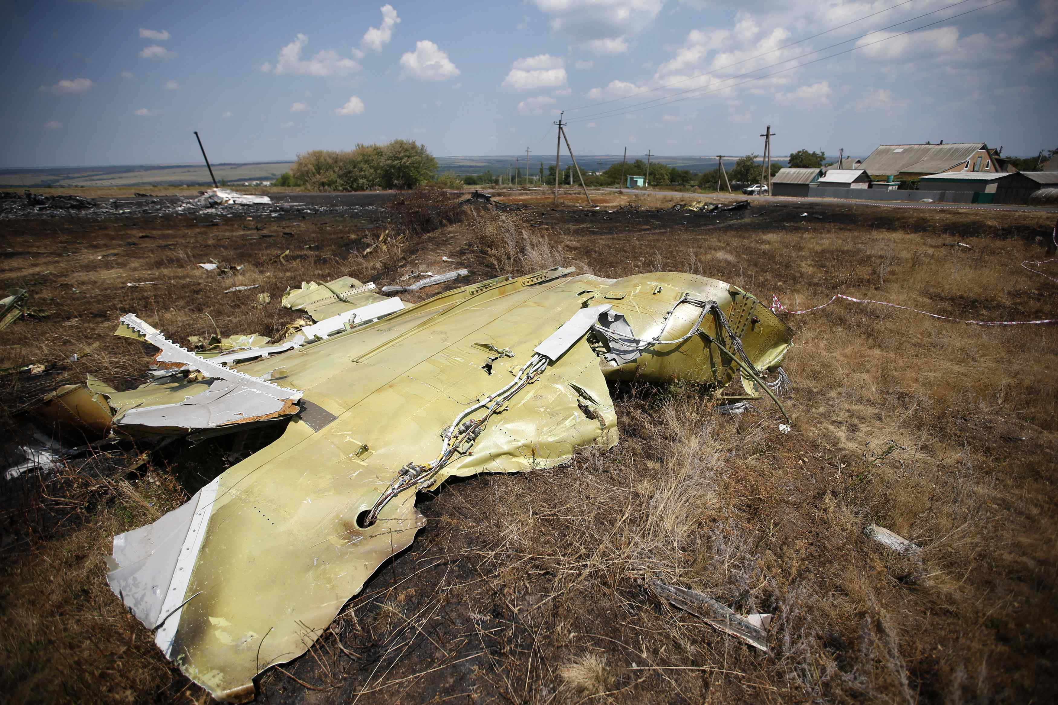 Debris is seen at the site where Malaysia Airlines MH17 crashed last Thursday, near Hrabove, Grabovo, in Donetsk yesterday.