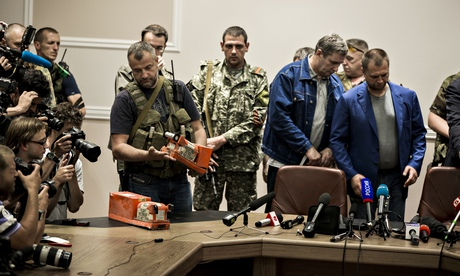 Ukraine rebels hand over MH17's black boxes to Malaysian government officials in Donetsk.