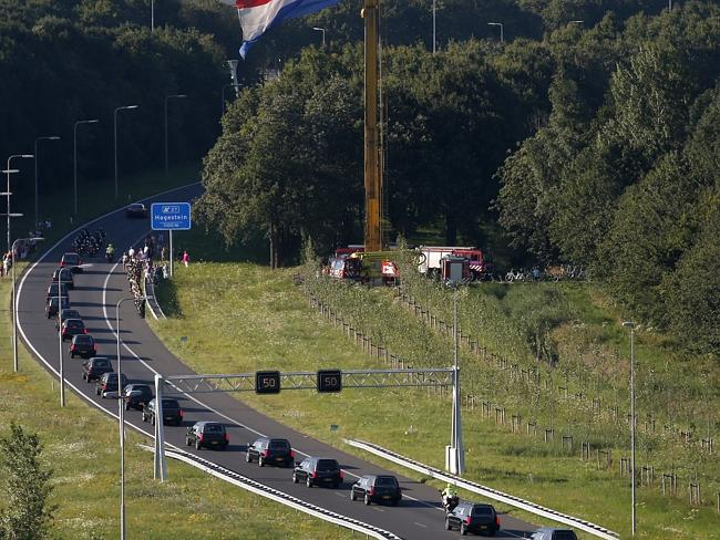 Solemn procession ... a convoy of funeral hearses containing the bodies of victims of the downed Malaysia Airlines flight MH17 drives from the Eindhoven Airbase to Hilversum
