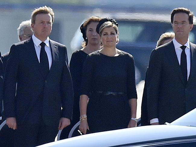 King Willem Alexander, his wife Maxima and prime minister Mark Rutte, from left, during a ceremony to mark the return of the first bodies of victims of the downing of MH17.